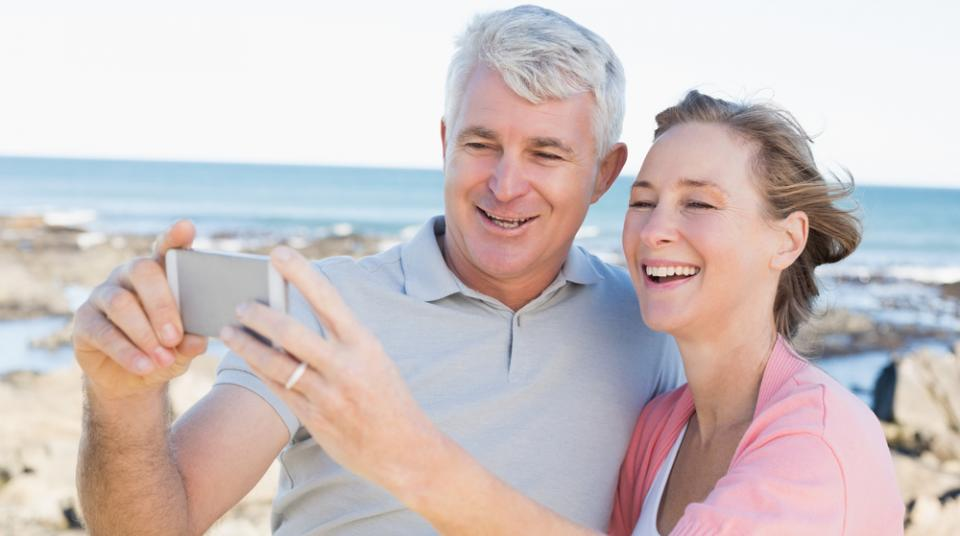 Couple looking at mobile device